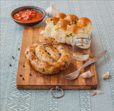Ring homemade sausage and glasses of vodka Stock Photo