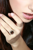 Ring with a jewel. Portrait of the lady with the big ring with a jewel on a finger stock photos