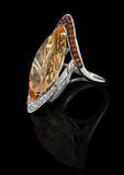 Ring with jewels. Precious Ring with brilliants and with topaz Royalty Free Stock Photography