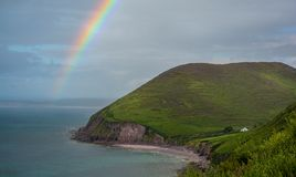 Rainbow in a rainy afternoon on the Ring of Kerry coastline, Ireland stock images