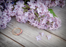 Ring and lilac on wood Royalty Free Stock Image