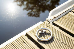 Ring for the mooring of boats. On wooden pier Royalty Free Stock Images
