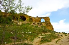 Ring Mountain near the town of Kislovodsk, Caucasus, Russia. Mountain with a through hole against the blue sky with clouds stock photography