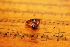 Ring on music sheet stock image