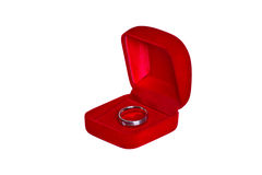 Ring in open red velvet box isolated on white Stock Images