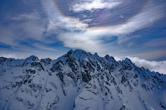 Ring over Olympic Mountains. Sun ring above mountain Royalty Free Stock Photos
