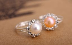 Ring with pearl. On brown paper Royalty Free Stock Image