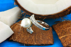 Ring with pearl on coconut stock photo