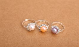 Ring with pearl. On brown paper Stock Images