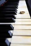 Ring on a piano Stock Images