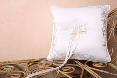 Ring Pillow. On an old style rustic seat Royalty Free Stock Photography
