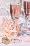 Ring in pink champagne with flowers Royalty Free Stock Photo