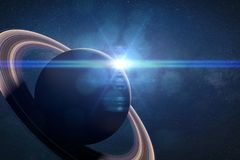 Intense sunrise over the planet Saturn, 3d render, elements of this image are furnished by NASA. The ring planet lit by the Sun Stock Photo