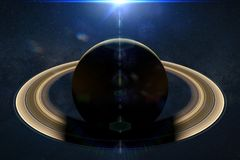 Intense sunrise over the planet Saturn. The ring planet lit by the Sun Stock Photo