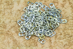 Ring pull aluminum of cans on grunge paper sheet background Royalty Free Stock Photography