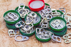 Ring pull aluminum of cans on grunge paper sheet background Stock Image