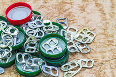 Ring pull aluminum of cans on grunge paper sheet background Stock Photos