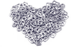 Ring pull aluminum of cans stack as heart shape indicate of new Stock Images