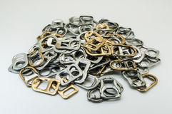 Ring pull. A pile recycling ring pull stock image