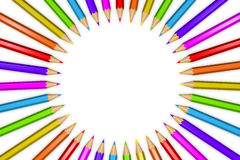 Ring of rainbow colored pencils creating a circle shape isolated over white background. 3D rendered illustration of a ring of rainbow colored pencils creating a Royalty Free Stock Image