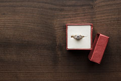 Ring in the red box on the table. Ring in the red box on wooden table royalty free stock photography