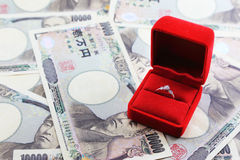 Ring in red box with yen banknotes in background Royalty Free Stock Photos