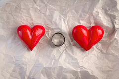 Ring with Red Hearts Over crump paper.jpg Royalty Free Stock Image