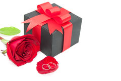 Ring, red rose and black gift box Stock Photo
