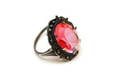 Ring with red stone isolated on the white Stock Photos