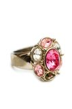 Ring with red stones. Isolated on the white Royalty Free Stock Image