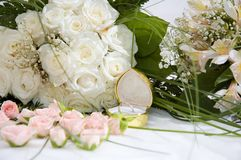 Ring and roses. Wedding ring and roses Royalty Free Stock Photos