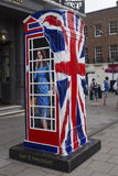 Ring a Royal phone box Royalty Free Stock Image