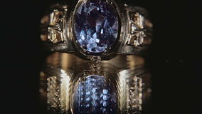 Ring with Sapphire on black stock video footage
