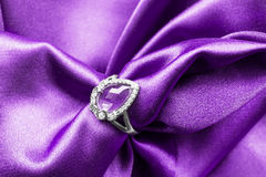 Ring on satin Royalty Free Stock Photos