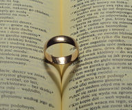 Ring and shadow. In a marriage book Royalty Free Stock Photos