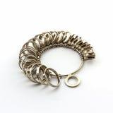 Ring Sizing. Chrome Jeweler finger sizing tools on white background Stock Image