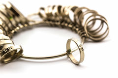 Ring Sizing. Chrome Jeweler finger sizing tools on white background Royalty Free Stock Photos