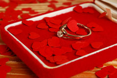 Ring with small red hearts Stock Images