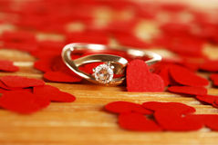 Ring with small red hearts Stock Photos