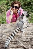 Ring-tailed lemur and young caucasian woman Stock Photo