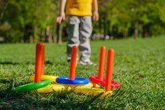 Ring throw summer game on a green lawn in the sun. Made of plastic stock photography