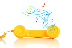Ring-tone. Retro phone and ring-tone. Isolated over white royalty free stock photo