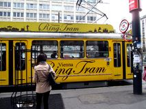 Ring Tram old and traditional transport in Vienna. With people waiting to climb Stock Image