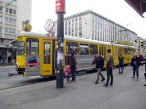 Ring Tram old and traditional transport in Vienna. With people waiting to climb Royalty Free Stock Photography