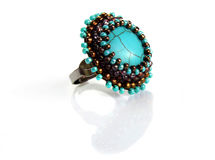 Ring with turquoise and beds Stock Images