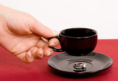 Ring under the cup of coffee. Gold ring with sapphire, under the cup of coffee stock images