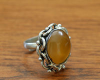 Ring with a yellow stone Royalty Free Stock Photography