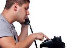 ringande gammal roterande telefon för man Fotografering för Bildbyråer