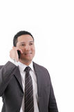 Ringer den talande mobilen för affärsman Royaltyfri Bild