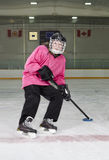 Ringette Skater in Action at Rink Stock Image